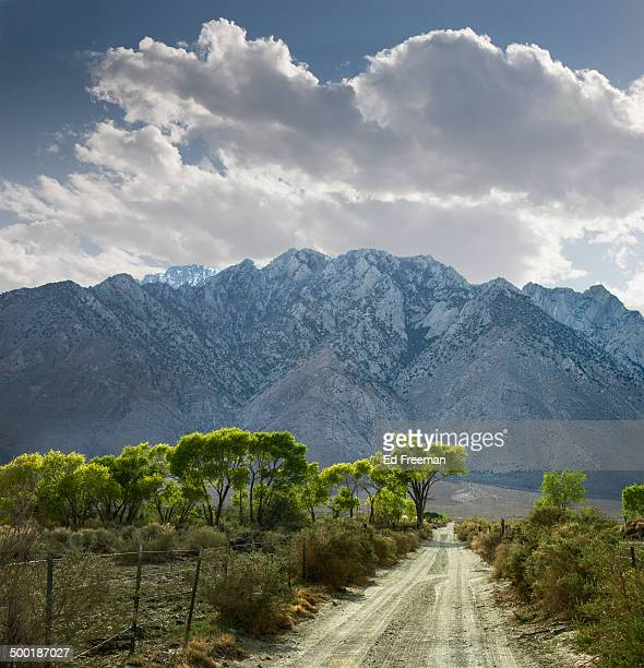 dirt road and mountains - lone pine california stock pictures, royalty-free photos & images