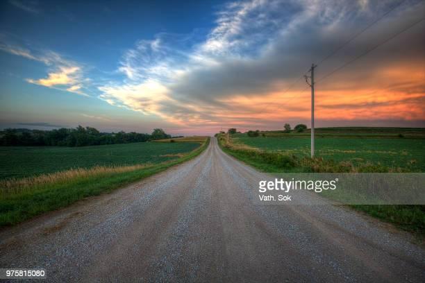 dirt road at sunset, nebraska, usa - nebraska stock pictures, royalty-free photos & images
