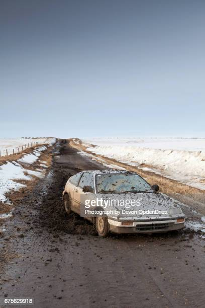 dirt road car problems vertical - compact car stock photos and pictures
