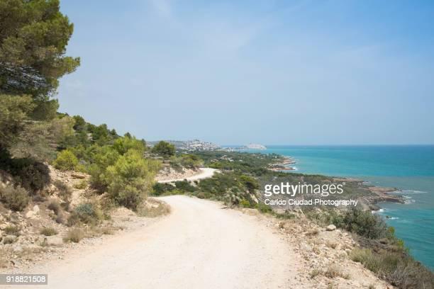 dirt road in sierra de irta natural park , peniscola, castellon, spain - castellon province stock pictures, royalty-free photos & images