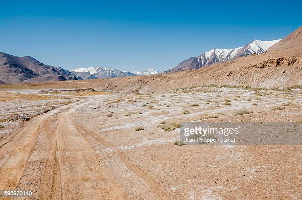 A dirt road in the high plateau of the Pamirs in Tajikistan, Central Asia
