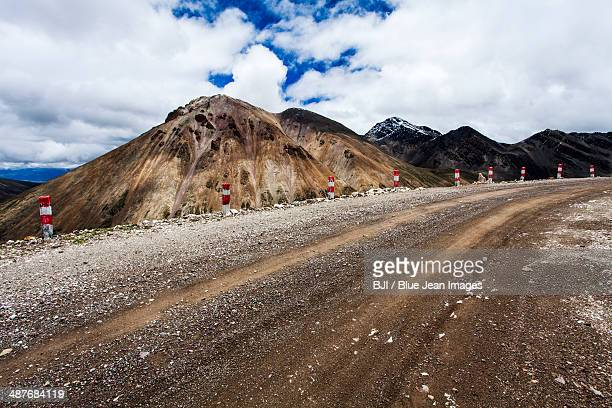 dirt road in tibet, china - rough stock pictures, royalty-free photos & images