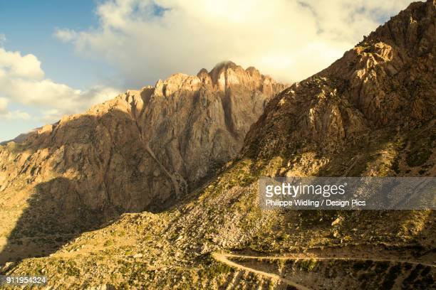 Dirt Road On A Mountain Side In The Andes At Sunset