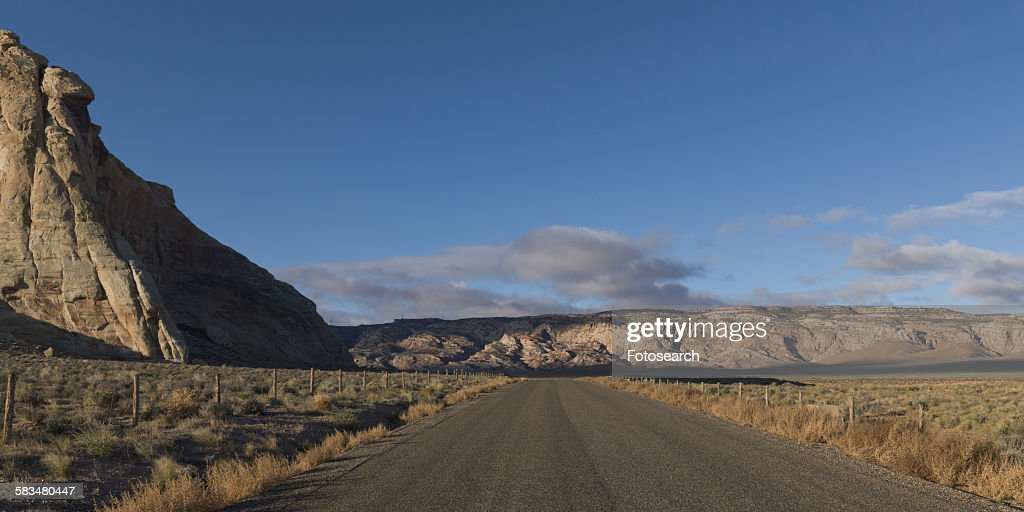 Dirt road passing through a landscape : Stock Photo