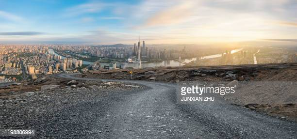 dirt road pavement and guangzhou city buildings skyline - guangzhou stock-fotos und bilder