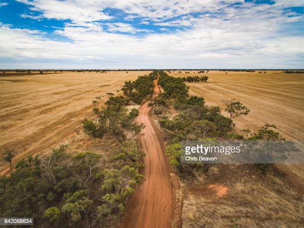 dirt road - country road stock pictures, royalty-free photos & images