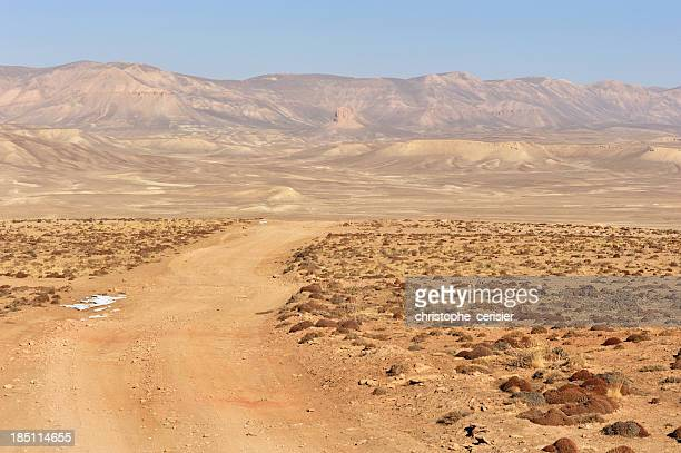 dirt road through desert, afghanistan - afghanistan stock pictures, royalty-free photos & images