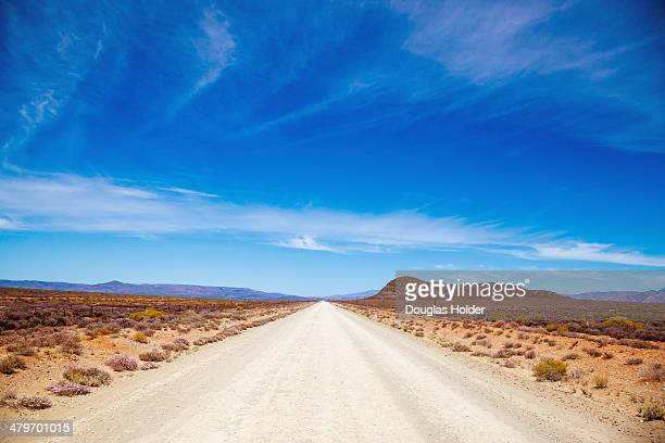 a dirt road through the great karoo, breede river valley, breede river valley, western cape province, south africa - the karoo stock photos and pictures
