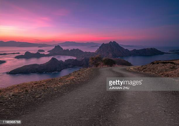 dirt road to the beautiful scenery of island padar of indonesia - archipelago stock pictures, royalty-free photos & images