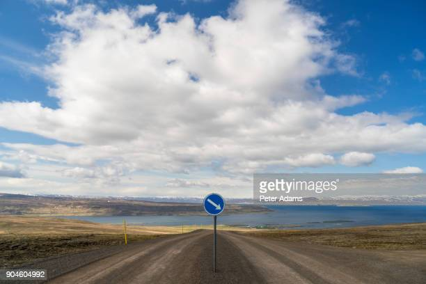 Dirt road with keep right road sign, West Fjords, Iceland