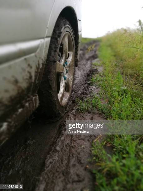 dirt wheel offroad road after rain - beaten up stock pictures, royalty-free photos & images