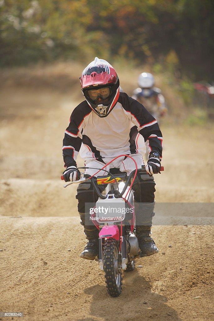 Dirtbiking over Mounds : Stock Photo