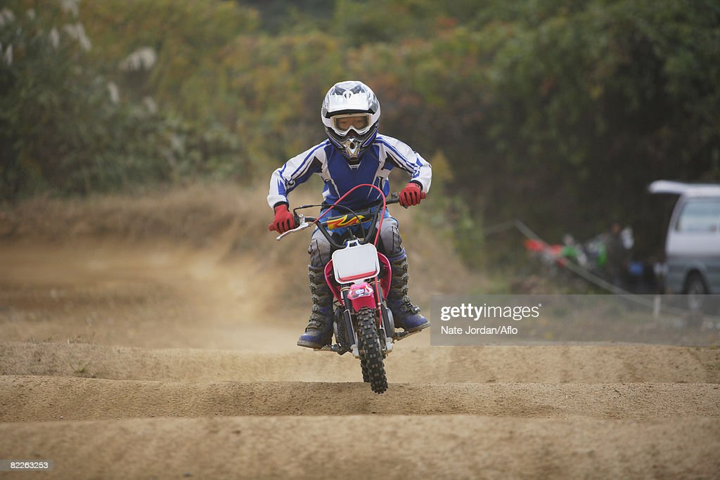Dirtbiking over Mounds : Stock Photo