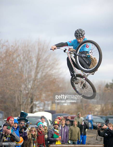 Dirt-jumper jumps over ramp at cycling event