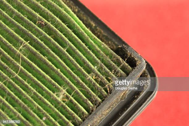 Dirty Air Filter on a red background