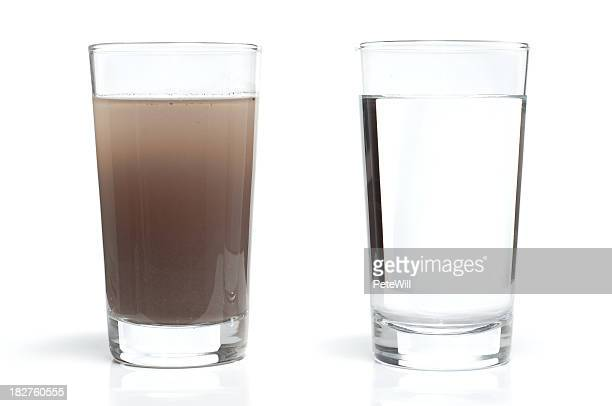 dirty and clean water in glasses - water stockfoto's en -beelden
