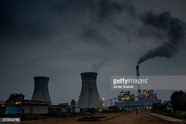Dirty black smoke spewing out of a chimney at a coal power plant in the Indian state of Jharkhand Jharia in India's eastern Jharkand state is...