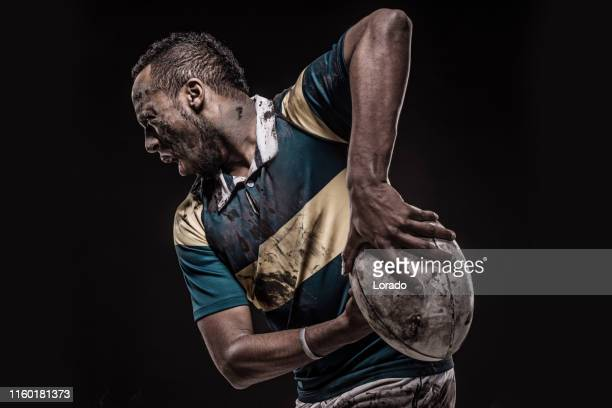 a dirty bloodied rugby player - rugby union stock pictures, royalty-free photos & images