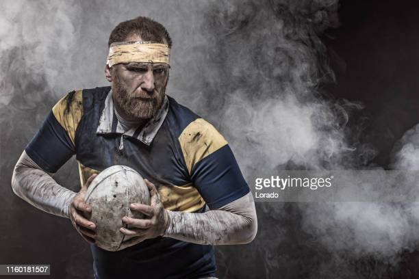 a dirty bloodied rugby player - rugby stock pictures, royalty-free photos & images