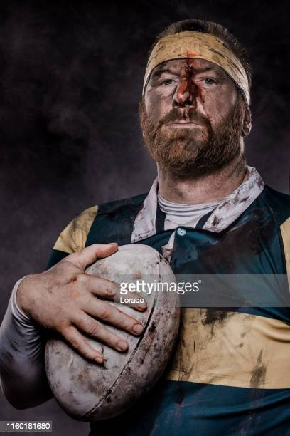 a dirty bloodied rugby player - tackling stock pictures, royalty-free photos & images