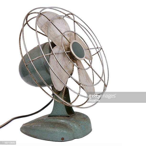 A dirty blue and silver retro metal fan on white background