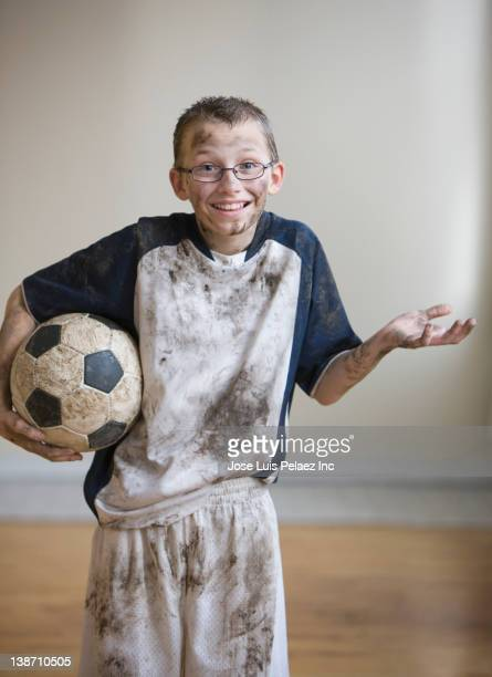 dirty caucasian boy holding soccer ball - west new york new jersey stock pictures, royalty-free photos & images