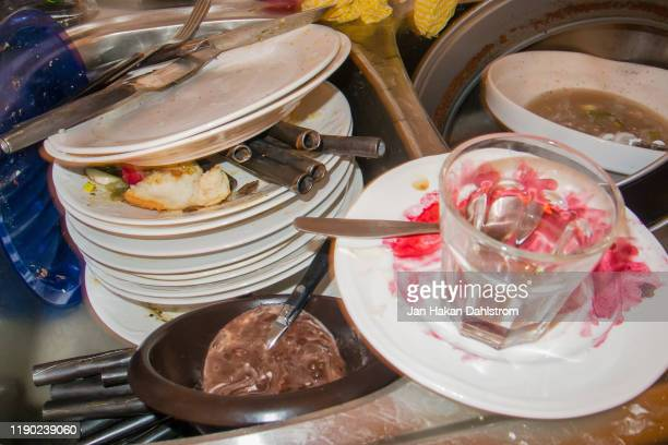 dirty dishes after dinner party - cleaning after party stock pictures, royalty-free photos & images