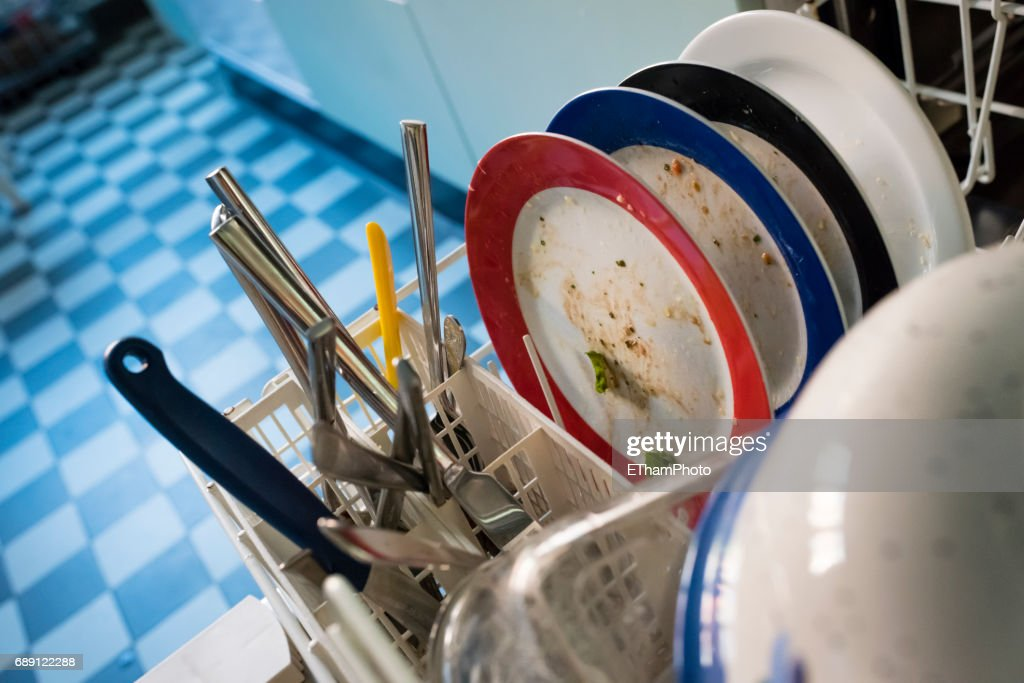 Dirty dishes in a dishwasher : Stock Photo