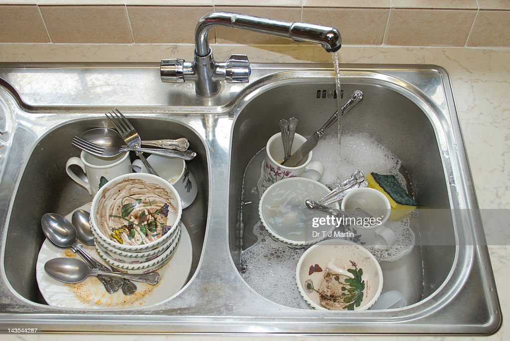 Dirty Dishes In Kitchen Sink Stock Photo | Getty Images