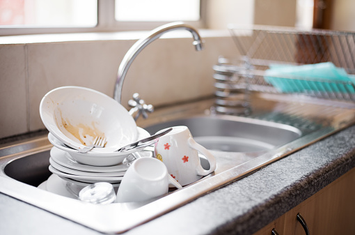 Dirty dishes in the sink 1135955779