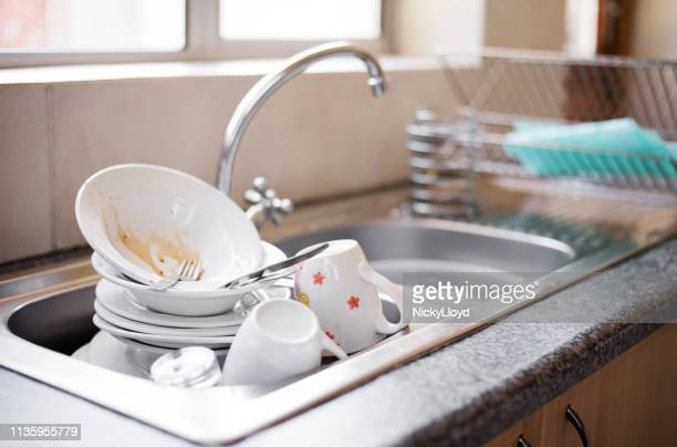 dirty dishes in the sink - lavandino foto e immagini stock