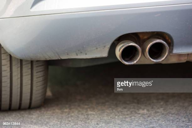 Dirty exhaust pipe of a car (Berlin, Germany)