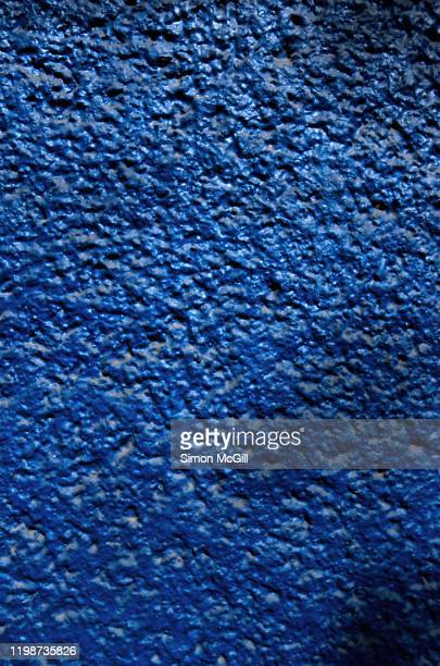 dirty exterior building wall painted blue - すす ストックフォトと画像