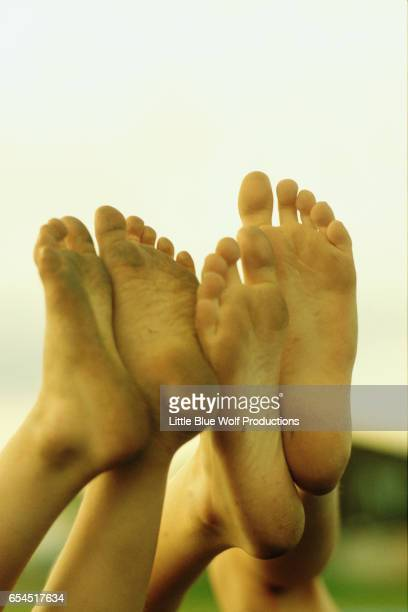 dirty feet of two boys - dirty feet stock pictures, royalty-free photos & images