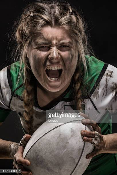 a dirty female rugby player - rugby stock pictures, royalty-free photos & images