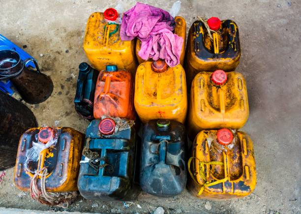 Dirty gasoline canisters, market, Nampan, Shan State, Myanmar
