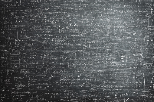 dirty grunge chalkboard full of mathematical problems and formula 898683510