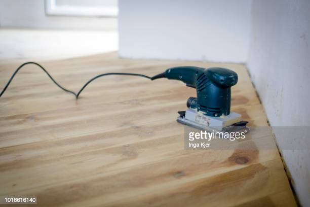 A dirty hand grinder stands on a wooden floor on July 24 2018 in BERLIN GERMANY