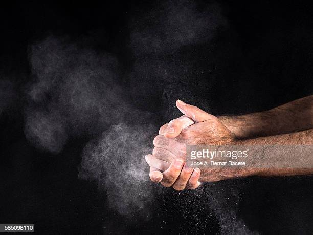 Dirty hands of a man, covered with dust, slapping