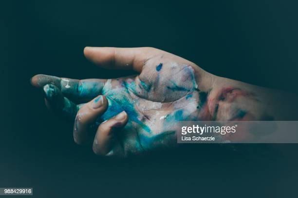 dirty hands of an artist full of paint - creativity stock-fotos und bilder