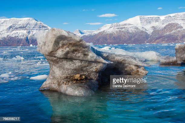 Dirty iceberg from bottom of glacier, Krogen, Gasefjord, Scoresby Sund, Greenland, Denmark