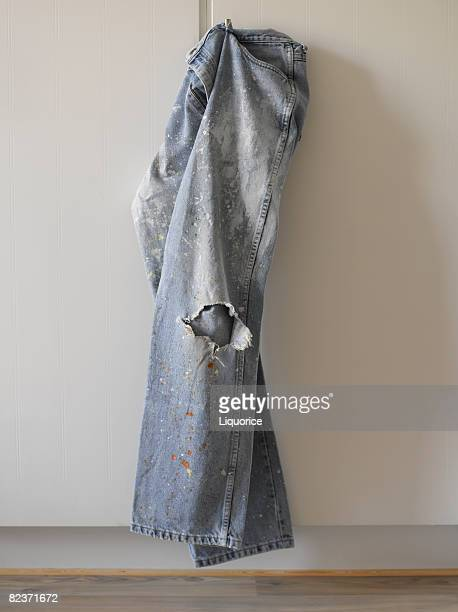 dirty jeans hanging on door - pants stock pictures, royalty-free photos & images