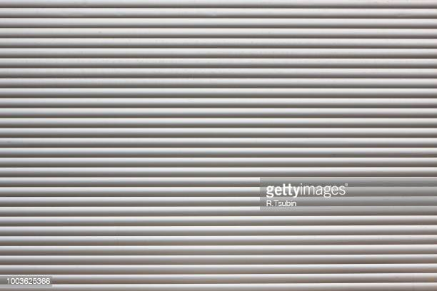 dirty metal roller shutter door as a background