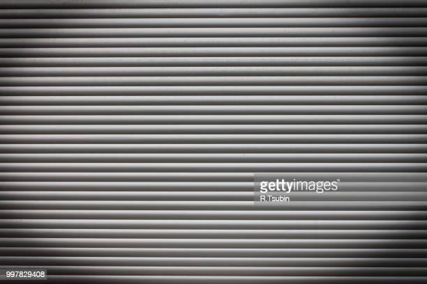 dirty metal roller shutter door as a background