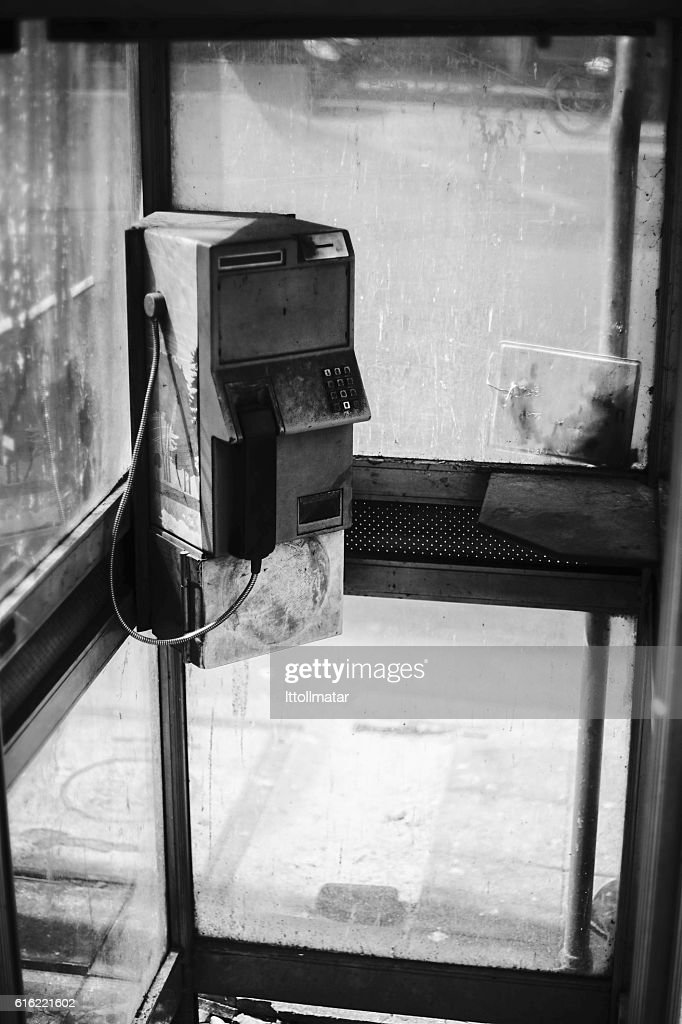 dirty old public telephone in thailand : Stock Photo
