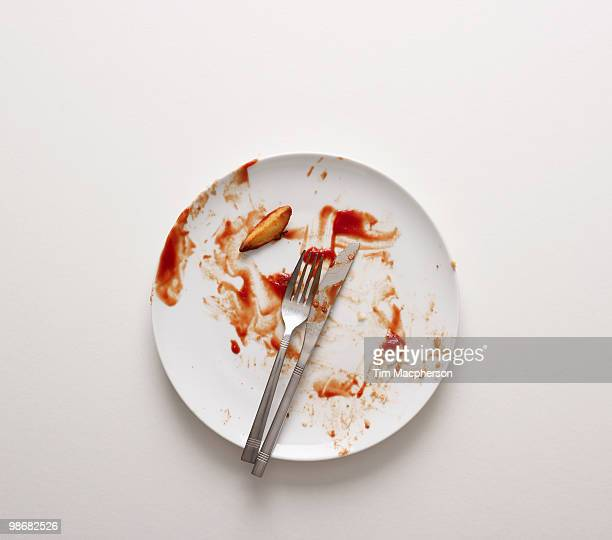 a dirty plate - tomato sauce stock pictures, royalty-free photos & images