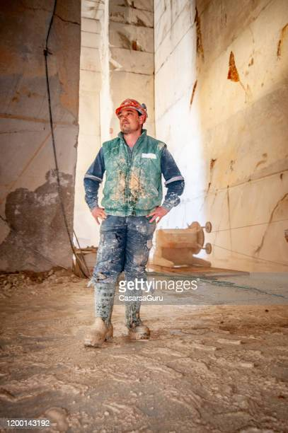 dirty quarry worker standing in underground corridor - stock photo - hand on hip stock pictures, royalty-free photos & images