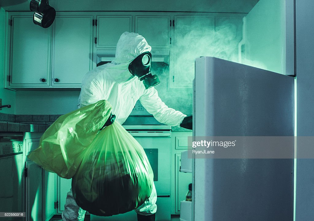 Dirty Refrigerator Cleaning In Hazmat Suit Stock Photo ...