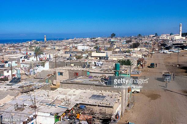Dirty road and houses close to the sea in a refugee camp Since the SixDay War in 1967 Jewish Israeli people occupied the Gaza Strip and the West Bank...