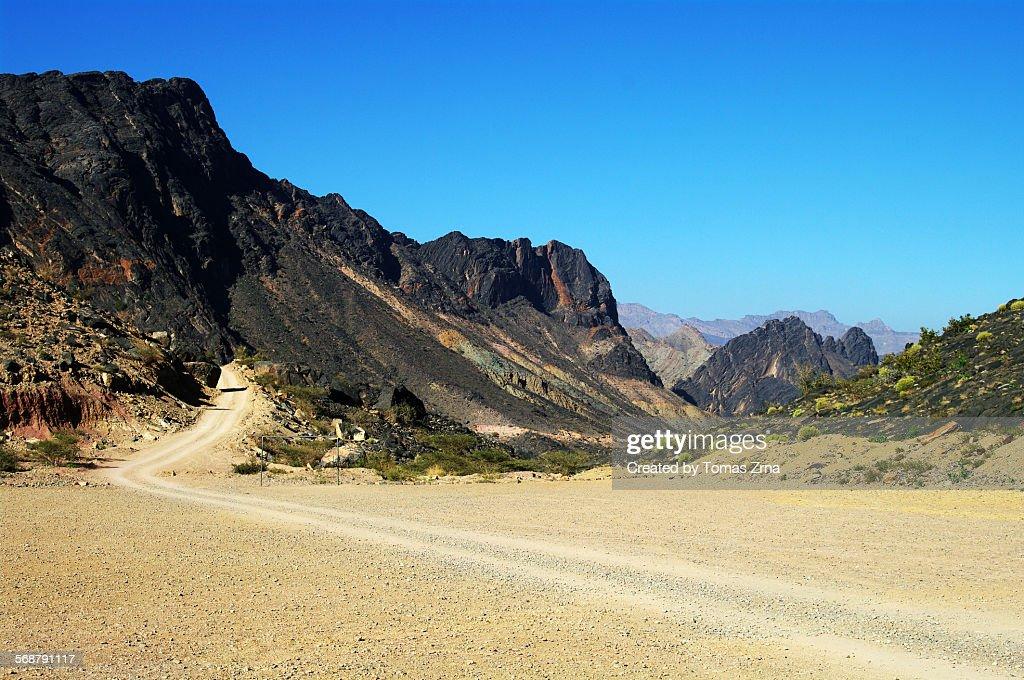 Dirty road tracks in Hajar mountains : Stock Photo